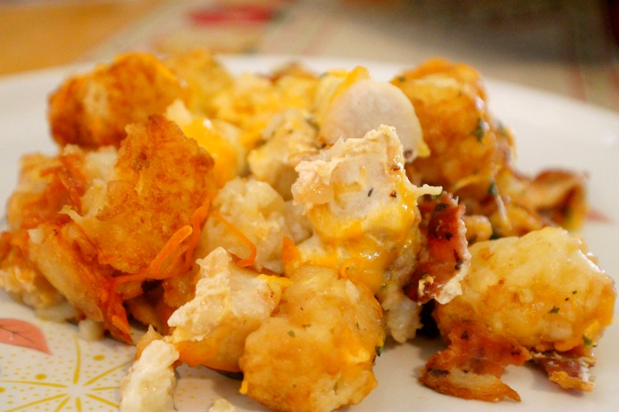 Tater Tot Breakfast Pizza recipe with crispy potatoes, scrambled eggs, melted cheese, crispy bacon, and sausage is a delicious breakfast or holiday brunch!